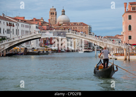 View of the Grand Canal in front of the train station from a public waterbus, Venice, Veneto, Italy, Europe - Stock Photo