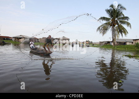 Fishing in Ganvie lake village on Nokoue Lake, Benin, West Africa, Africa - Stock Photo