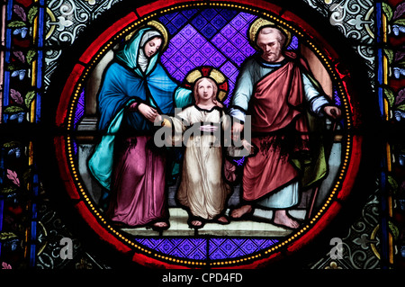 Holy Family stained glass in Sainte Clotilde church, Paris, France, Europe - Stock Photo