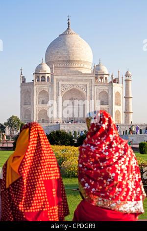 Women in colourful saris at the Taj Mahal, UNESCO World Heritage Site, Agra, Uttar Pradesh state, India, Asia - Stock Photo