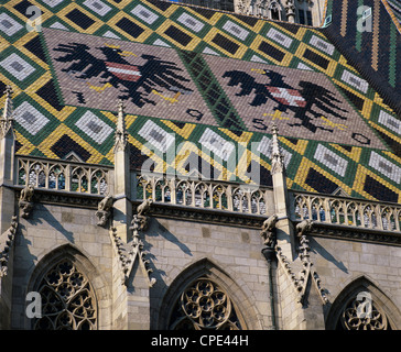 St. Stephen`s Cathedral with coat of arms on roof, UNESCO World Heritage Site, Vienna, Austria, Europe - Stock Photo