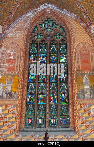 Frescoes and window showing life of Virgin Mary in Matthias Church (Matyas-Templom), Buda, Budapest, Hungary, Europe - Stock Photo