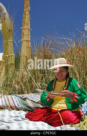 Portrait of a Uros Indian woman, Islas Flotantes (Floating Islands), Lake Titicaca, Peru, South America - Stock Photo