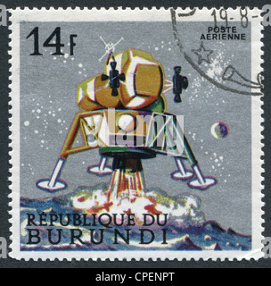 REPUBLIC OF BURUNDI-CIRCA 1968: A stamp printed in the Burundi, is dedicated to Apollo landing on the Moon, circa - Stock Photo
