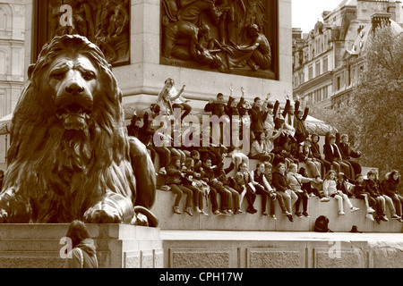 The base of Nelson's Column in Trafalgar Square, London, on a sunny spring day - Stock Photo