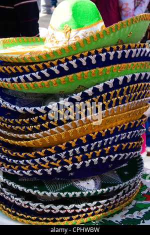 Stack of colorful Mexican sombreros for sale at sidewalk shop. Mexican Independence Day Minneapolis Minnesota MN - Stock Photo