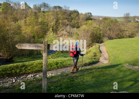 Coast to coast walker in boots, man travelling in the North Yorkshire National Park, Pennine Way Track, near Keld, - Stock Photo