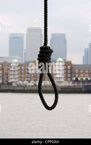Hangman's noose in front of Canary Wharf, London - Stock Photo