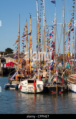 summer flags bunting in Yarmouth Harbour Isle of Wight - Stock Photo