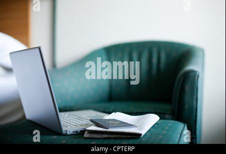 Laptop and passport - Stock Photo