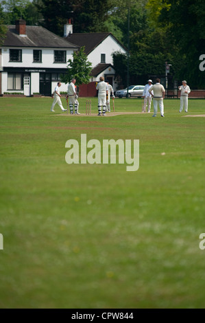 Vllage cricket match at Ham Common in the London Borough of Richmond upon Thames, England, UK - Stock Photo