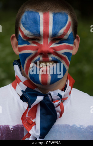 Monarchists celebrate their Queen's Diamond Jubilee weeks before the Olympics come to London. The UK gears enjoys - Stock Photo