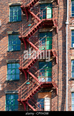 Fire escape staircase on a derelict factory.  By the Ashton Canal, Ancoats, Manchester, England, UK - Stock Photo
