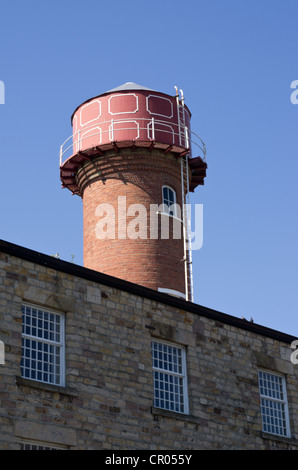 Circular cast iron water tower on brick base, old mill Moor Lane Lancaster. Grade II listed. - Stock Photo