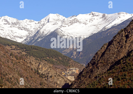View from La Plana in Andorra La Vella looking north towards the remote mountain village of Sispony in front of - Stock Photo