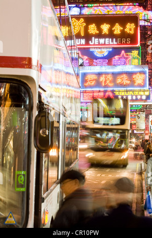 China, Hong Kong, Kowloon, Nathan Road, bus and commercial neon lights - Stock Photo
