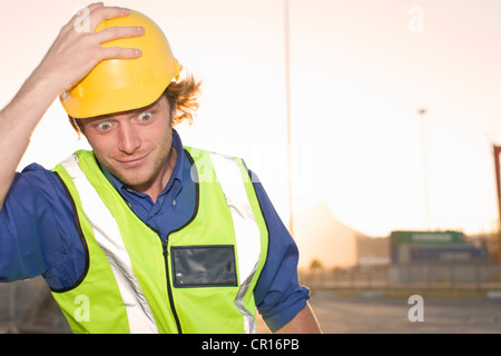 Construction worker wearing hard hat - Stock Photo