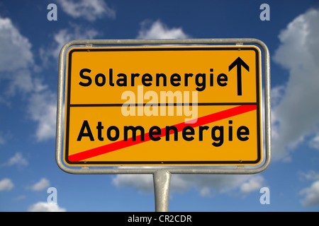 German road sign nuclear energy and solar energy with blue sky and white clouds - Stock Photo