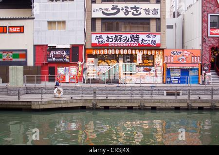 An Okonomiyaki shop in the Dōtonbori area of Osaka, Japan - Stock Photo