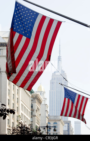 American national flags, Empire State Building, Manhattan, New York, USA - Stock Photo
