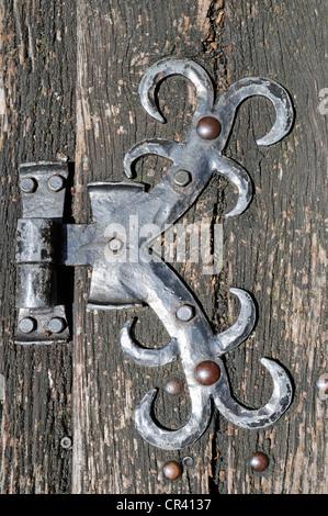 Old metal fittings on a wooden door, hinge, Ratingen, Dusseldorf, North Rhine-Westphalia, Germany, Europe, PublicGround - Stock Photo