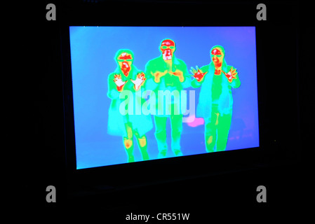 Thermographic image registers infrared heat signature.  Hotter areas appear red, cooler blue. - Stock Photo
