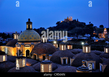 Roof of the Convento de San Gabriel monastery at night in front of the church of Iglesia Nuestra Senora de los Remedios - Stock Photo