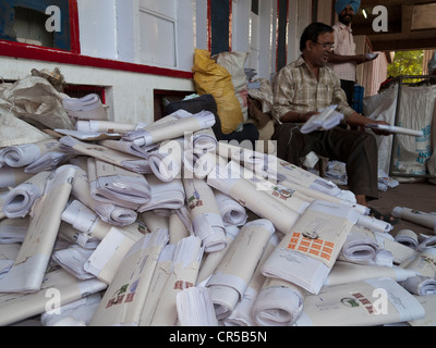 Employee sorting letters in front of the main post office in the capital of Himachal Pradesh, Chandigarh, India, - Stock Photo
