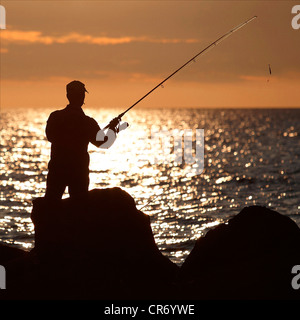 Angler on the shore of the Baltic Sea, Warnemuende, Mecklenburg-Western Pomerania, Germany, Europe - Stock Photo