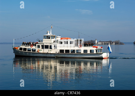 Ferry on Lake Chiemsee, Frauenchiemsee island, also know as Fraueninsel island at the back, Chiemsee, Upper Bavaria - Stock Photo