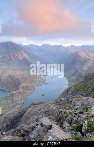 Pink clouds over Loch Coruisk at sunrise, taken from the summit of Sgurr na Stri, Isle of Skye, Scotland - Stock Photo