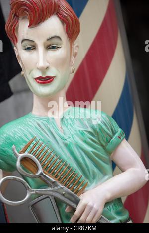 Hairdresser, barber shop, advertising in Shinsekai district, in Osaka, Kansai region, Japan. - Stock Photo