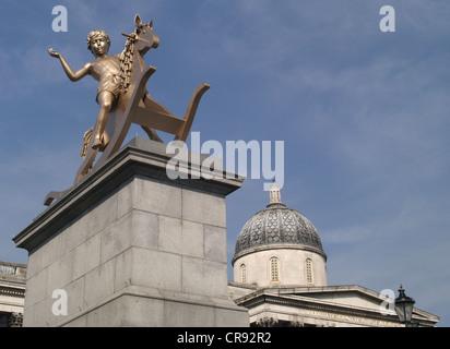 Fourth plinth in Trafalgar Square 'Boy on Rocking Horse' against a blue sky - Stock Photo