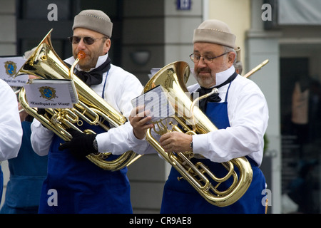 ZURICH - APRIL 16: Members of textil guild's orchestra during traditional annual spring parade of Guilds - Stock Photo