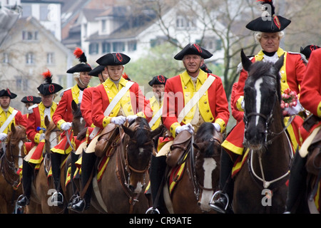ZURICH - APRIL 16: Members of traditional annual spring parade of Guilds, symbolizing end of the winter - Stock Photo