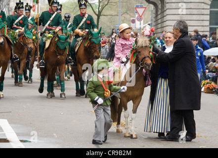 ZURICH - APRIL 16: unidentified Members of Zunft Hottingen guild during traditional annual spring parade of Guilds - Stock Photo