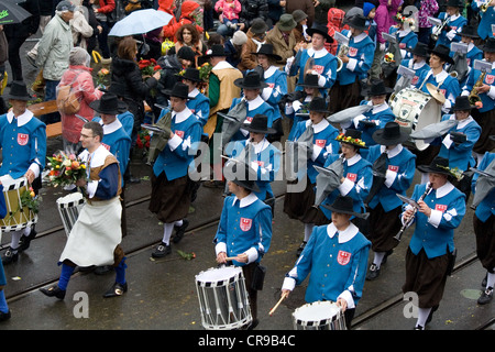 ZURICH - APRIL 16, 2012: Members of Carpenters' guild (Zunft zur Zimmerleuten) march in traditional spring parade - Stock Photo