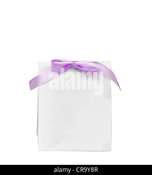 Blank note with purple bow isolated on white - Stock Photo