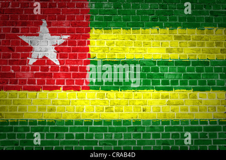 An image of the Togo flag painted on a brick wall in an urban location - Stock Photo