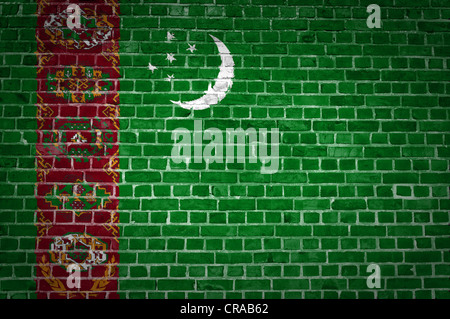 An image of the Turkmenistan flag painted on a brick wall in an urban location - Stock Photo