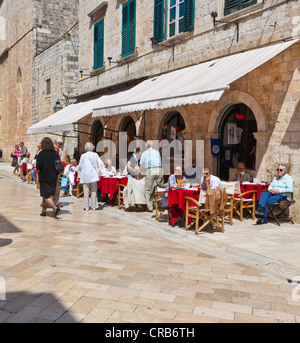 Restaurant on Stradun or Place, main street, in the old town of Dubrovnik, central Dalmatia, Dalmatia, Adriatic - Stock Photo