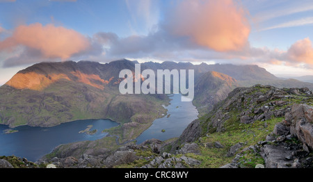 Pink clouds at sunrise over Loch Coruisk and the jagged peaks of the Black Cuillin, Isle of Skye, Inner, Hebrides, - Stock Photo