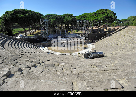 Ancient Roman theater in the Ostia Antica archaeological site, ancient port city of Rome, Lazio, Italy, Europe - Stock Photo