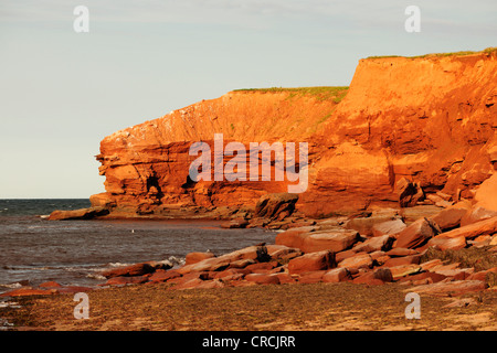 Red sandstone cliffs, typical coastline in Prince Edward Island National Park, Prince Edward Island, Canada - Stock Photo