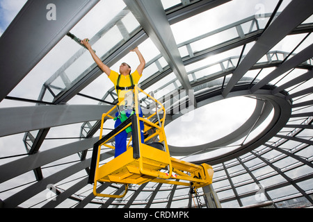 Window cleaner cleaning the dome of the Reichstag Building, Deutscher Bundestag, German parliament, Berlin, Germany, - Stock Photo