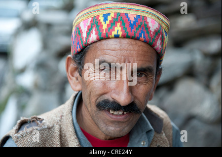 Portrait, Man wearing a typical brightly coloured decorated cap, Manali, Kullu district, the Himalayas, Himachal - Stock Photo