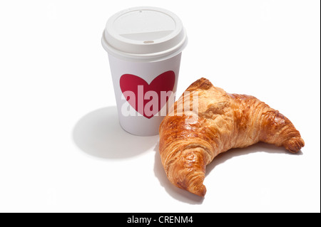 A croissant and a takeaway drink cup - Stock Photo
