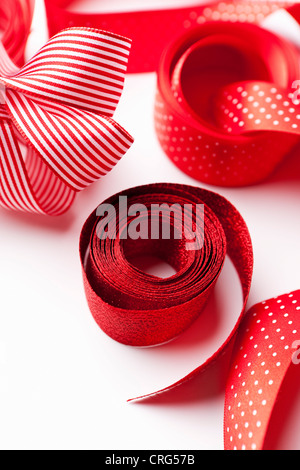 Close up of decorative red ribbons - Stock Photo