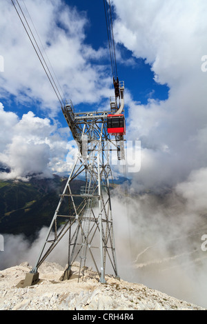 summer view of Primiero valley with cableway pylon on foreground, San Martino di Castrozza, Trentino, Italy - Stock Photo