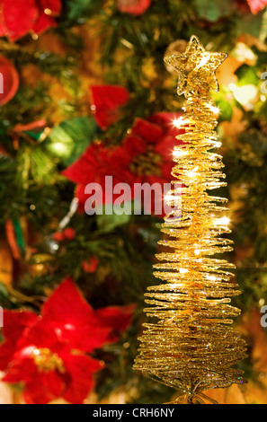 Christmas Eve Magic - greeting card with golden lights and decorated tree - Stock Photo
